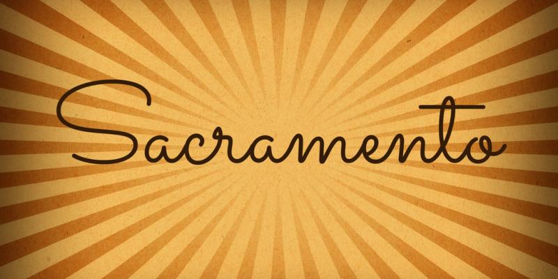 font tegak bersambung - Font Sacramento